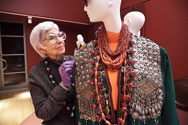 Iris helps carefully install her ensembles. Photo by PEM Walter Silver.